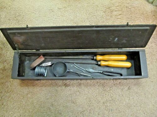 Antique Box with antique soldering equipment and soldering tin.