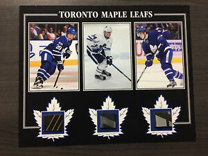 Matthews, Marner, Nylander game used sticks photo