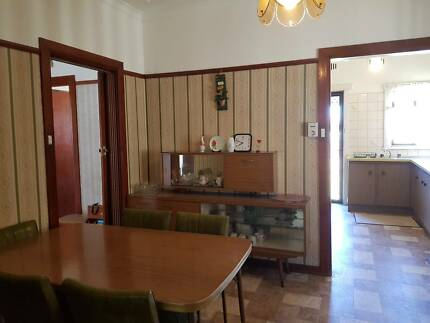 Dining room table and chairs and buffet