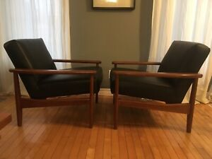 Pair of Mid century modern walnut and leather chairs