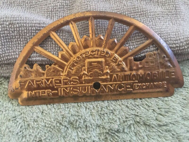 Vintage Collectible Farmers Insurance Exchange Automobile License Plate Topper!