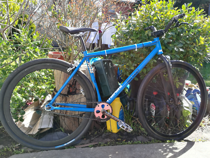 Blue single speed/fixie bicycle with brakes