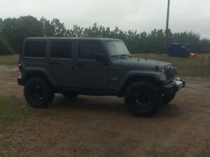 2015 Jeep Unlimited   Only $34 000