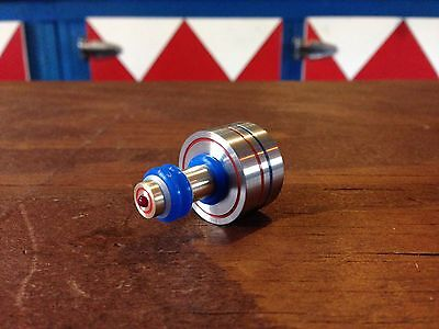 Custom metal spinning top. Stainless steel over brass. Precision machined.