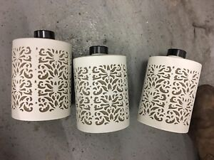 White ceramic canisters made in bali
