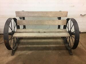 Garden bench steel made with antique wagon wheels.