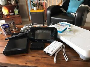 Wii U 32G with controllers, games, Wii fit.