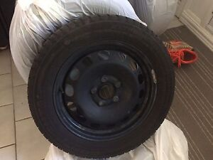 Used winter tires on rims from a Volkswagen
