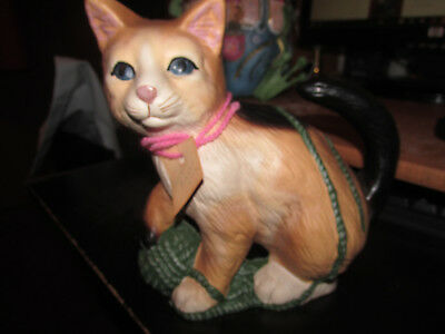 ( colorful cast iron KITTY door stop with ball of yarn)