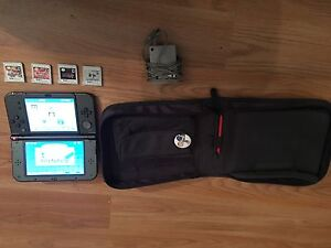 Nintendo new 3ds and games and pikachu case