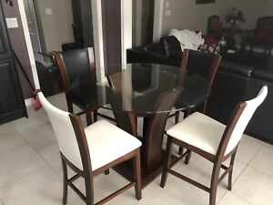 Table sold, just chairs, leather is real good 9/10 condition