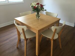 IKEA wooden table and white chairs