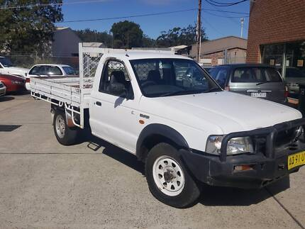 FORD COURIER CAB CHASSIS 5SPEED 4X4 TRAY TOP