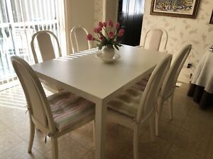 Kitchen table w/ 6 chairs (cream colour).