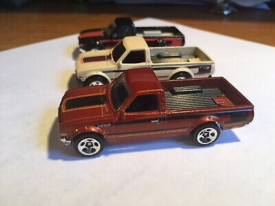 Hot Wheels Datsun 620 Pickup Truck Lot Of Three. Multi Pack Exclusives.