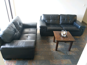 Beautiful black leather couches 3seater plus 2 seater $990