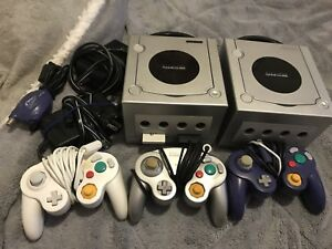 2 gamecube consoles +controllers and games