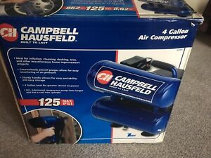 New in the box 4 Gallon Air Compressor with Hose and Tire Chuck
