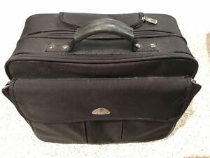 SAMSONITE CASE WITH HANDLE & ROLLERS -$25 OBO