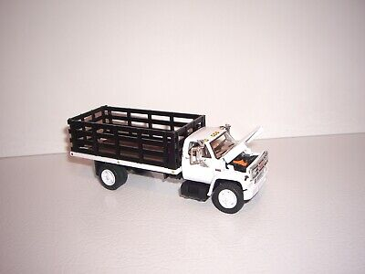 DCP FIRST GEAR 1/64 WHITE CAB BLACK STAKE SIDE GMC 6500 SINGLE AXLE STAKE TRUCK  3