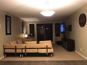 Beautifully furnished 2 Bedroom plus Den Adult Condo