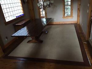 Rustic leather edged area rug 10x13