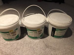 3 containers of accucolor grout (beige)