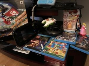 Wii u + games + controllers + charging station + gamepad