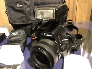 Nikon D5100 DSLR with flash and accessories