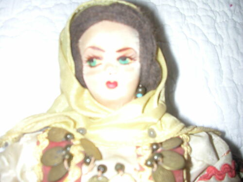 Vintage Hard Cloth Body Doll with Traditional Polish? Clothing