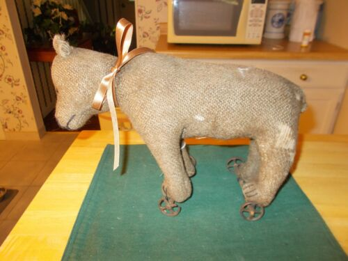LATE 1800S EARLY 1900S STEIFF BEAR ON WHEELS MADE OUT OF BURLAP WITH MOVABLE HEA