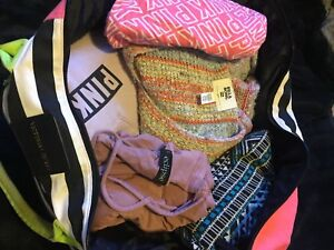 Brand name clothing in Victoria secret tote bag.