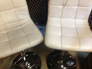 Two white leather chairs