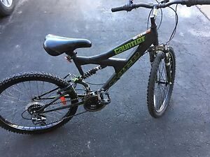 "Avigo 24"" bike black and green."