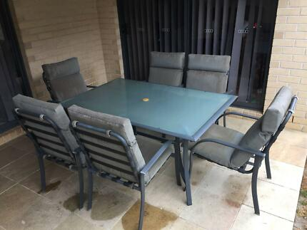 7 Piece Outdoor Setting - Glass Topped Table and 6 Chairs