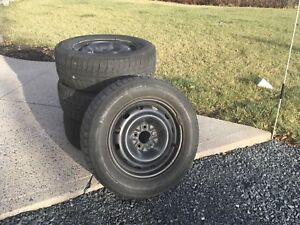 """GM 16"""" rims and snow tires"""
