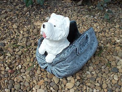 Dog in handbag planter concrete garden ornament