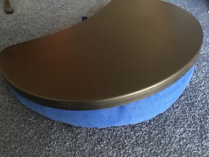 table with cushion underneath for laptop