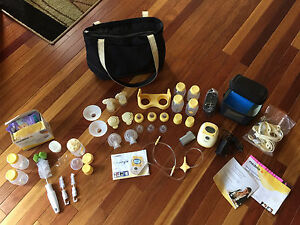Medela Freestyle hands free pump with extras