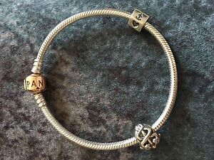 PANDORA Sterling silver bracelet with 2 charms