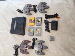 Nintendo 64 console + 4 games + 4 controllers + memory card lot