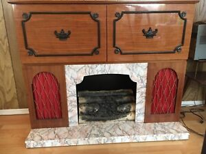 Vintage entertainment unit with fireplace, bar and stereo