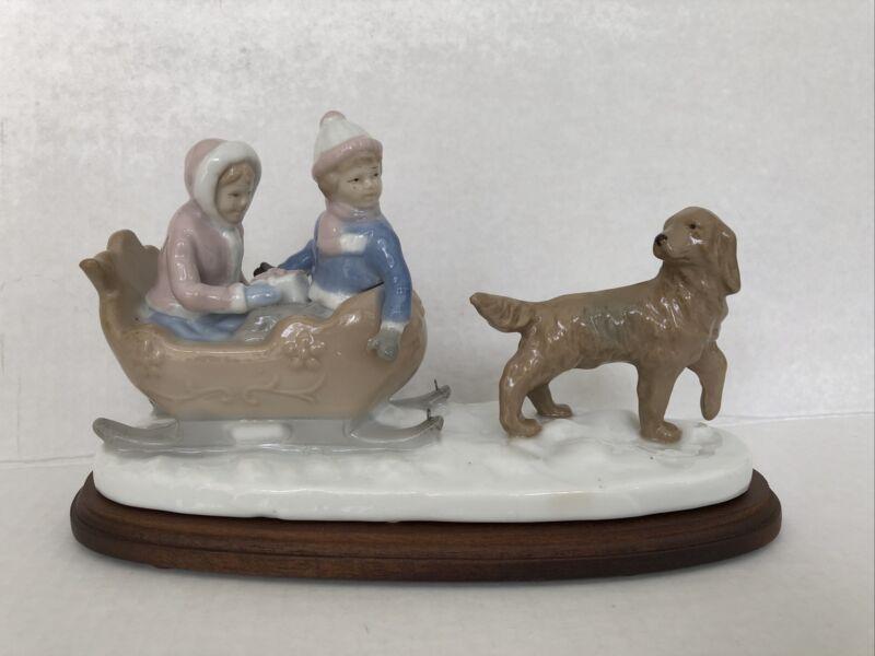 Meico Paul Sebastian Fine Porcelain Figurine Sleigh Ride Dog Pulling Sled w Kids