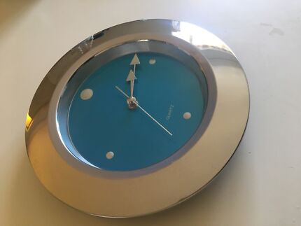Silver and blue wall clock