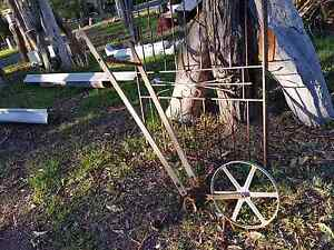 Vintage antique plough with silver coloured wheel Joyner Pine Rivers Area Preview