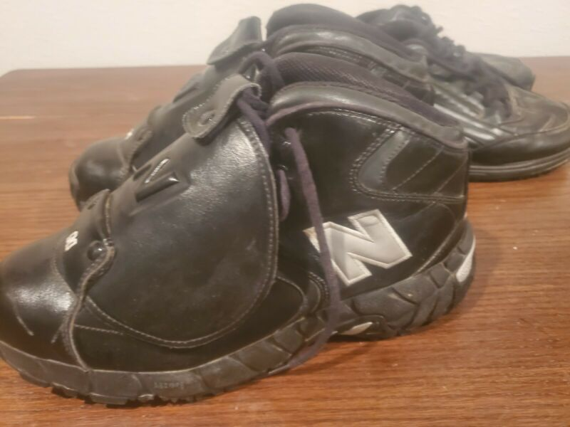 Quality Umpire Gear including chest protector, mask, shin guards, and shoes