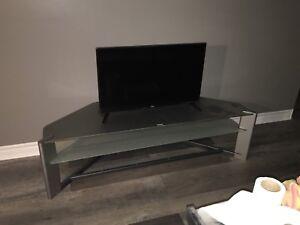 Tv(brand new), stand and DVD player.