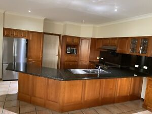 Solid timbre kitchen with granite benchtop