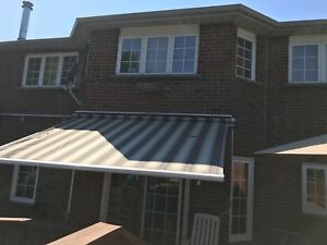 2 large retractable awnings for sale