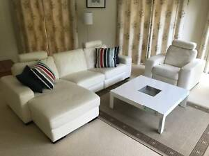 WHITE LEATHER LOUNGE WITH MATCHING SIDE CHAIR & WHITE COFFE TABLE